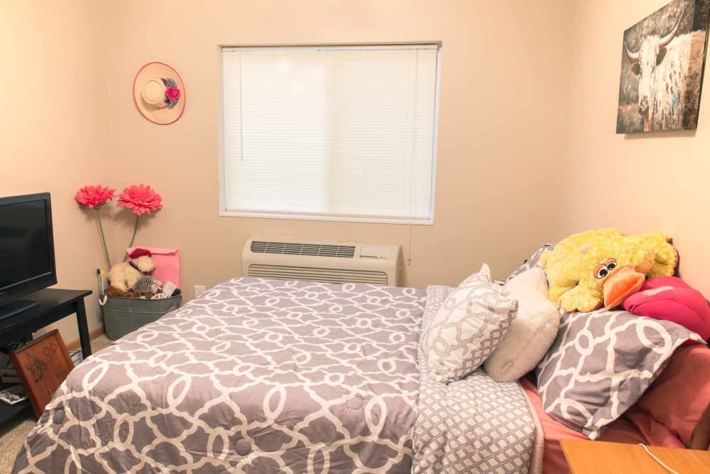 A decorated bedroom at Crown Point Apartments in Ames, Iowa