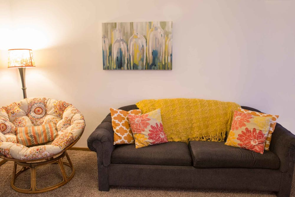 Comfortable seating in the living room at Crown Point Apartments in Ames, Iowa