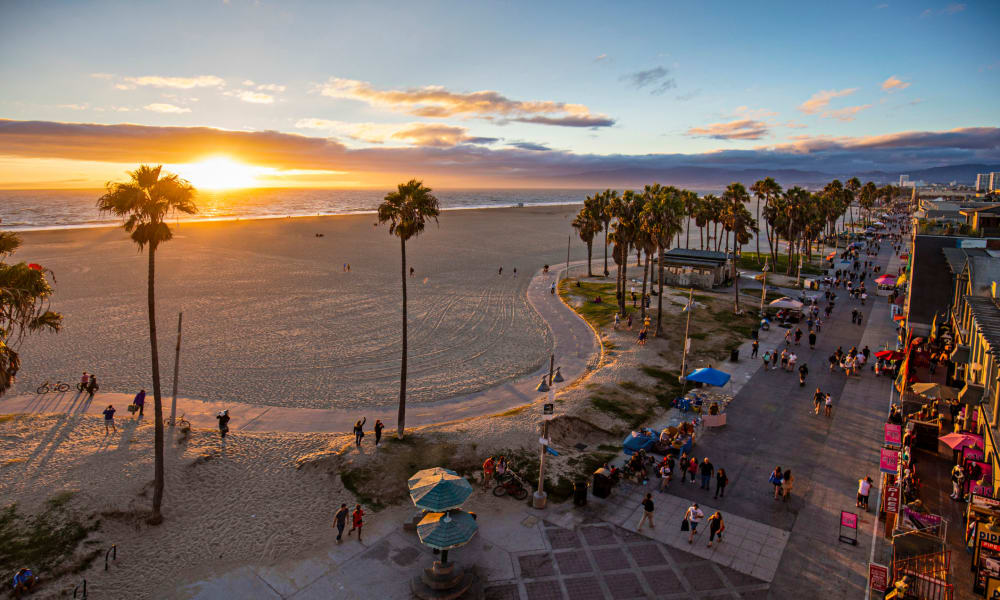 Low-aerial photo of Venice Beach and the boardwalk at sunset near The Tides at Marina Harbor in Marina Del Rey, California