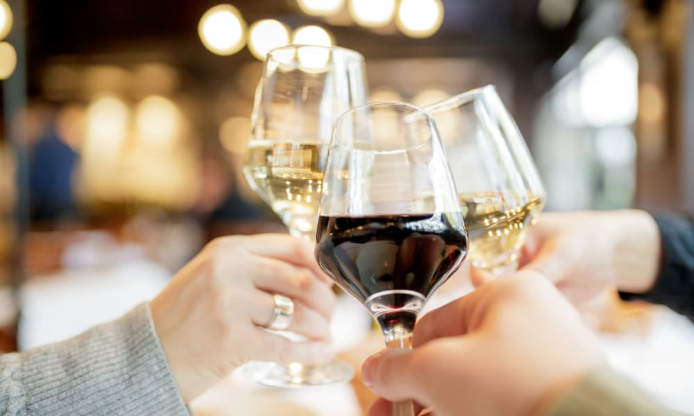 Residents raising a toast to the good life at their favorite restaurant near Valley Plaza Villages in Pleasanton, California