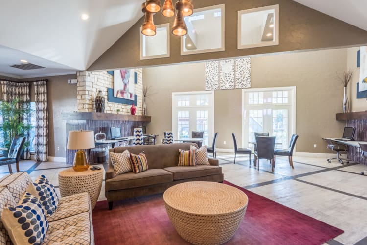 Relaxing clubhouse with ample seating and space at Sage at 1825 Apartments in Pflugerville, Texas