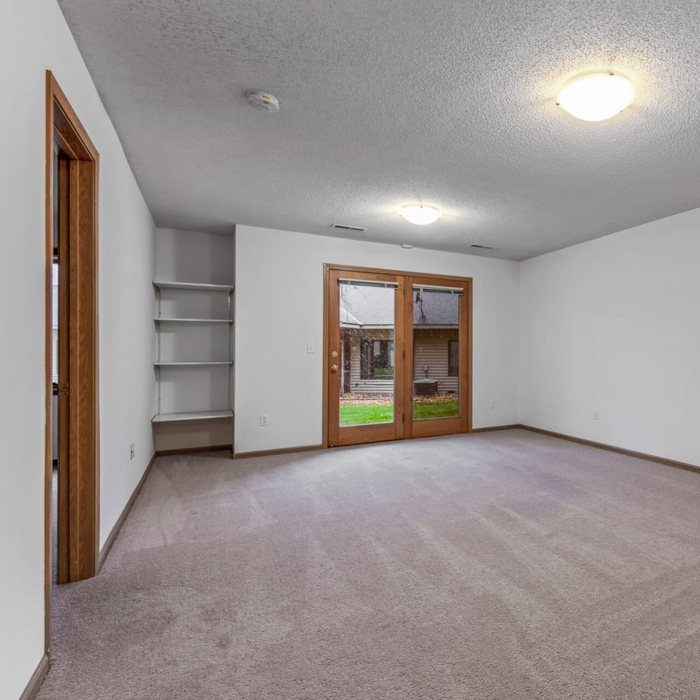 Spacious living area with  plush carpeting in a townhome at Oaks Lincoln Apartments & Townhomes in Edina, Minnesota