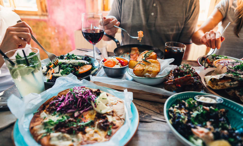 Residents enjoying a feast at their favorite restaurant at Waters Edge at Marina Harbor in Marina Del Rey, California
