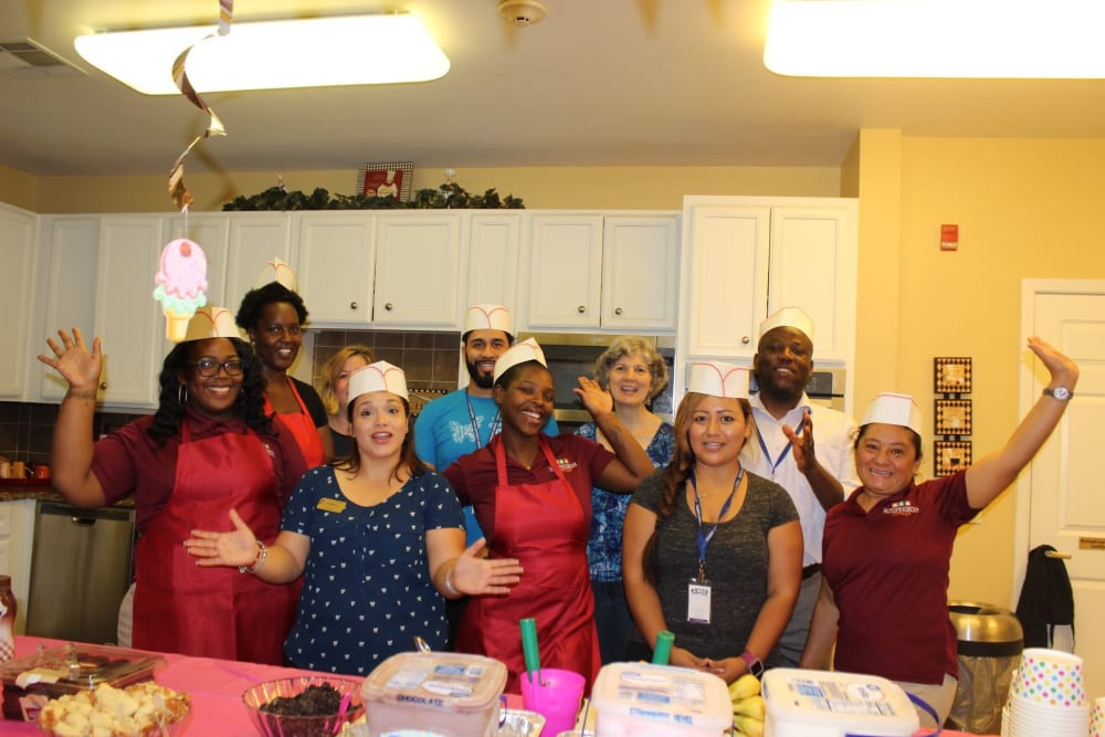 A group of happy caregivers in the kitchen at Autumn Grove Cottage at Copperfield in Houston, Texas