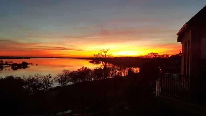 Beautiful sunrise view at Lake Lewisville near Olympus Boulevard