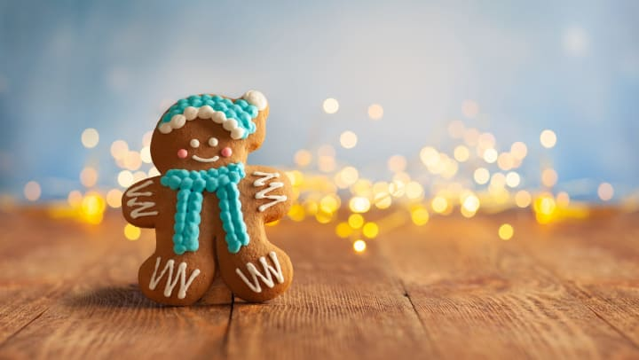 Cute gingerbread man standing in front of some lights