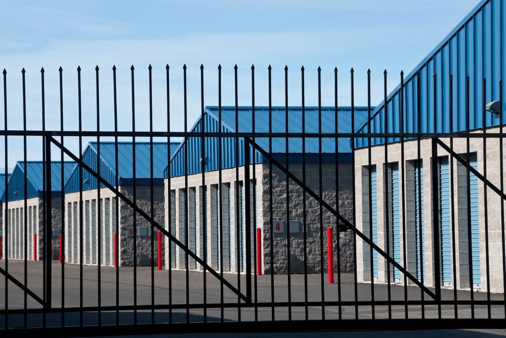 Fenced outdoor storage units at A-American Self Storage in Pomona, California