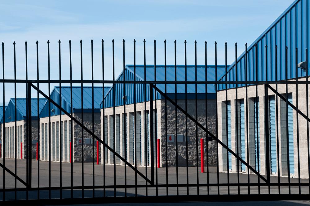 Fenced outdoor storage units at A-American Self Storage in Rialto, California