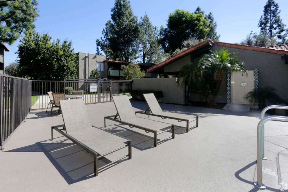 Lounge area by the pool at Olive Ridge in Pomona, California