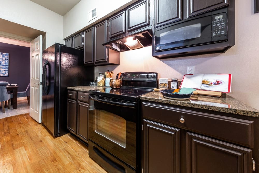 Model kitchen with sleek modern appliances at Marquis on Pin Oak in Houston, Texas