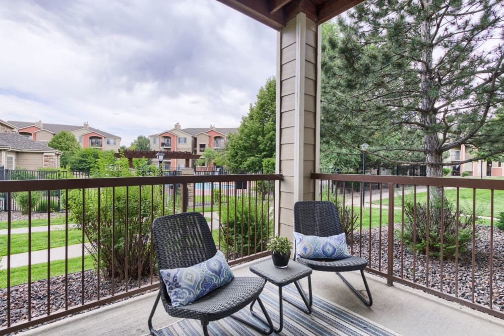 Patio area outside model apartment at Whisper Creek Apartment Homes in Lakewood, Colorado