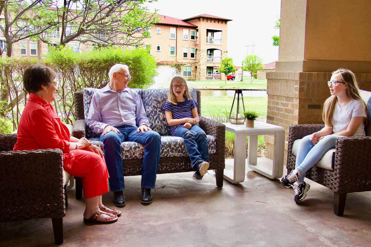A family spending time with their senior citizen at Landing at Watercrest Shadow Creek Ranch in Pearland, Texas