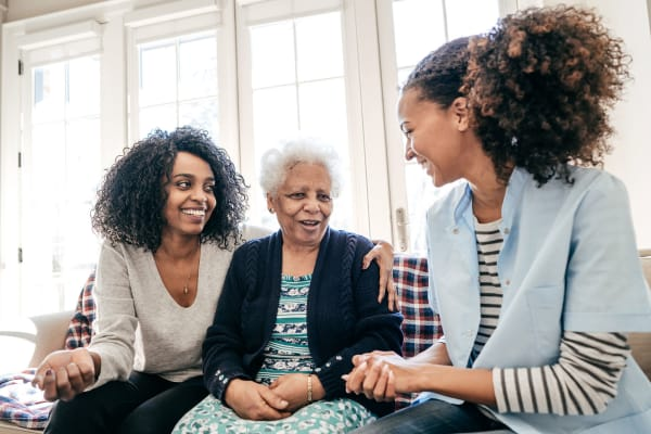 A resident and her daughters at Carefield Living.