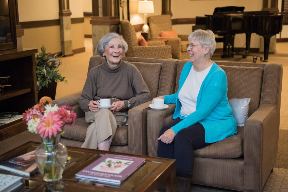 Two residents chatting over tea at The Springs at Tanasbourne in Hillsboro, Oregon