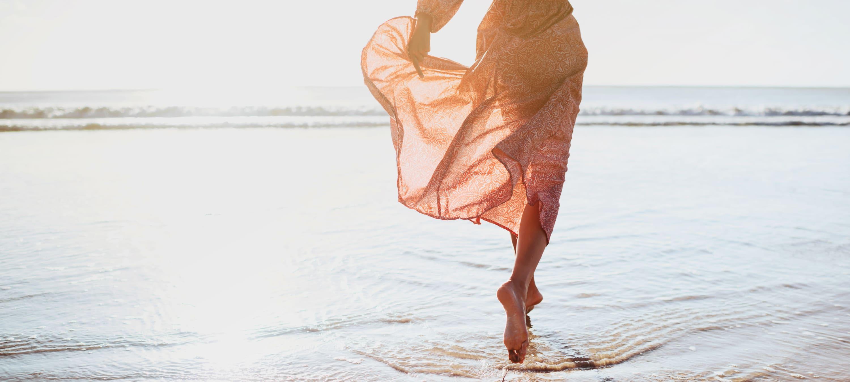 Woman running on the beach at Marina Harbor in Marina del Rey, California