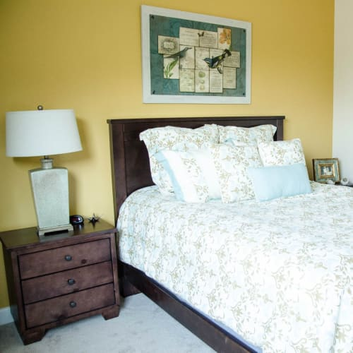 Tranquil bedroom suites available at First & Main of Commerce Township in Commerce Township, Michigan