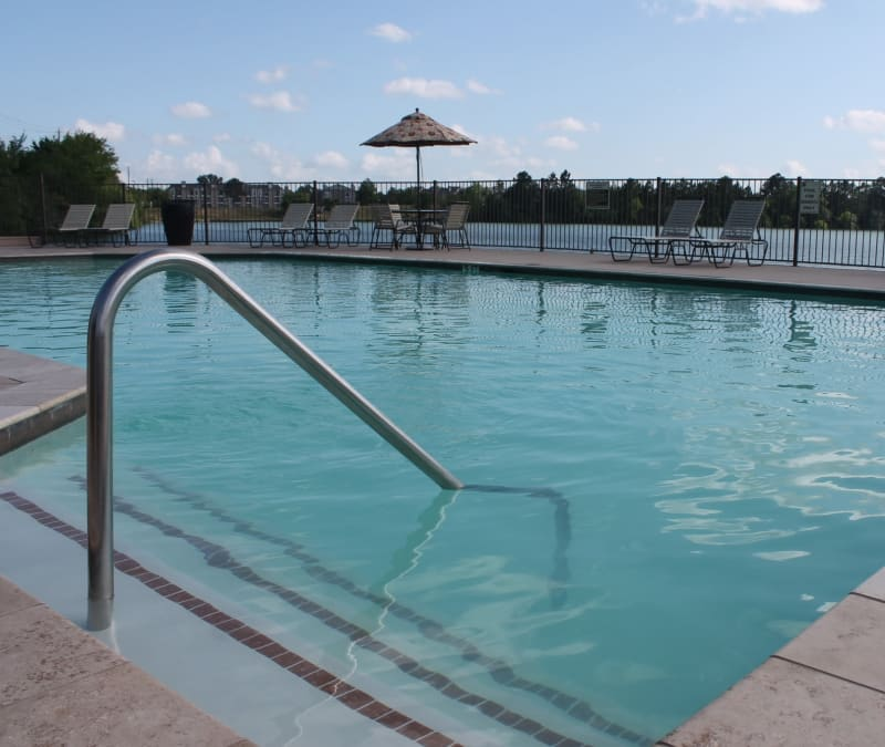 Large swimming pool with a sundeck at The Reserve at Windmill Lakes in Houston, Texas