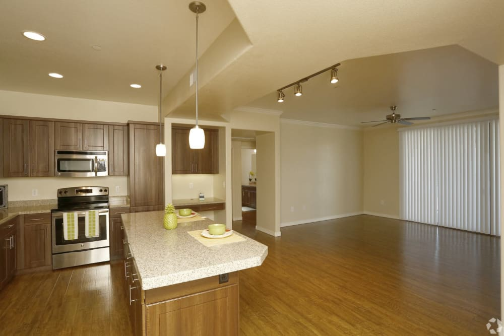 Spacious kitchen and dining room with hardwood floors at San Privada in Gilbert, Arizona