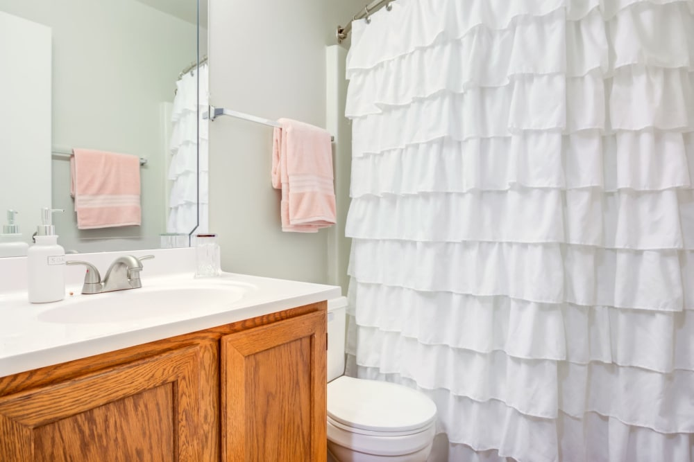 Our apartments in Aurora, Illinois have a cozy bathroom