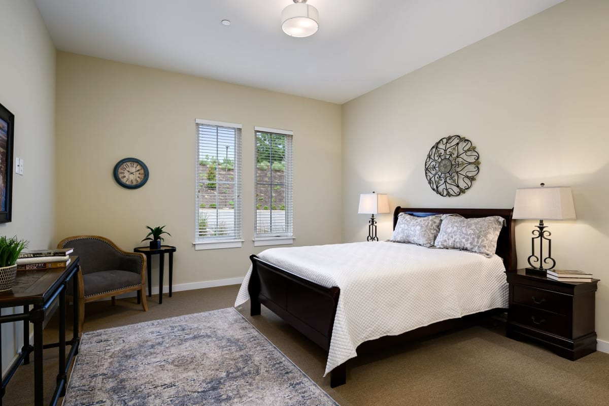 A spacious resident bedroom at The Claiborne at Shoe Creek in Central, Louisiana.