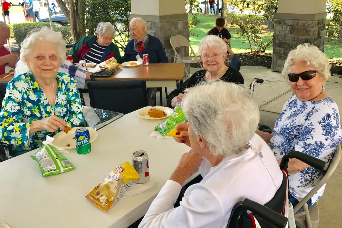Residents enjoying a light snack at Parsons House Cypress in Cypress, Texas