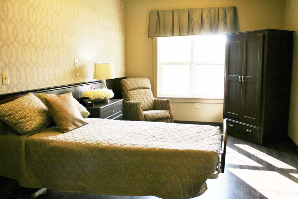 Cozy resident bedroom at The Willows at Springhurst in Louisville, Kentucky.