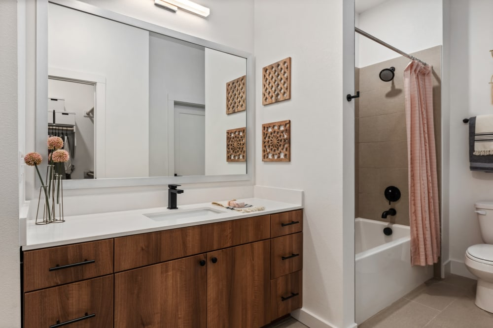 Artfully crafted wood cabinetry in a model home's bathroom at 4600 Ross in Dallas, Texas