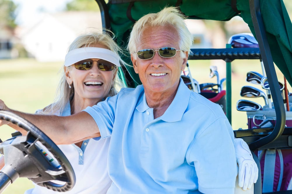 Senior couple in golf cart at Carnegie Heights at Henderson in Henderson, Nevada