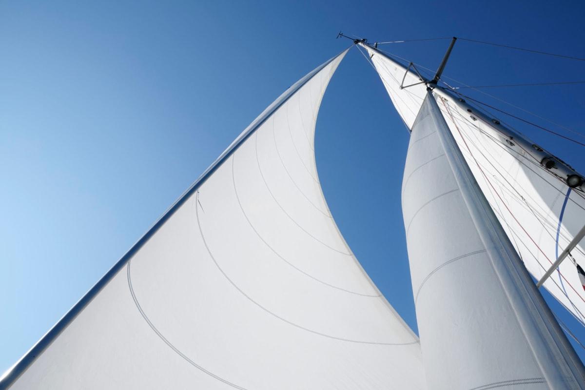 Looking up at a boat's sails from its deck near The Villa at Marina Harbor in Marina del Rey, California