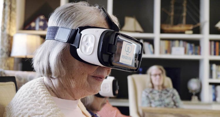 Senior using a VR headset at Maplewood at Brewster in Brewster, Massachusetts