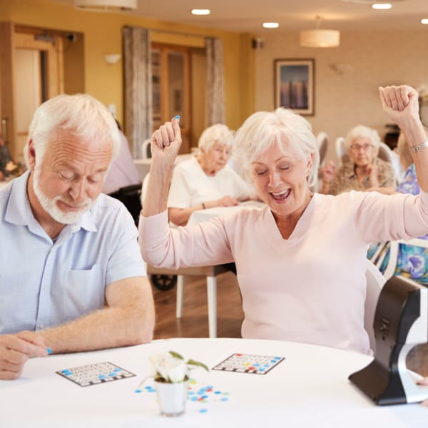 Residents playing games at Pacifica Senior Living Menifee in Sun City, California.