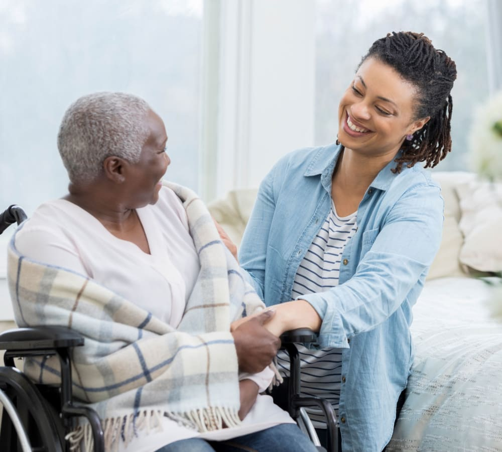 A resident talking to a care team member at Sage Mountain in Thousand Oaks, California.
