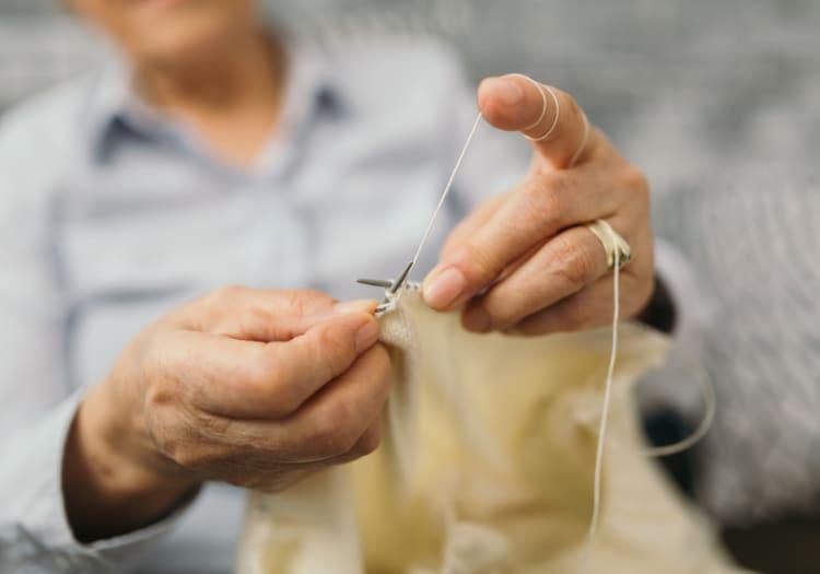 Senior making clothing at Estancia Del Sol in Corona, California