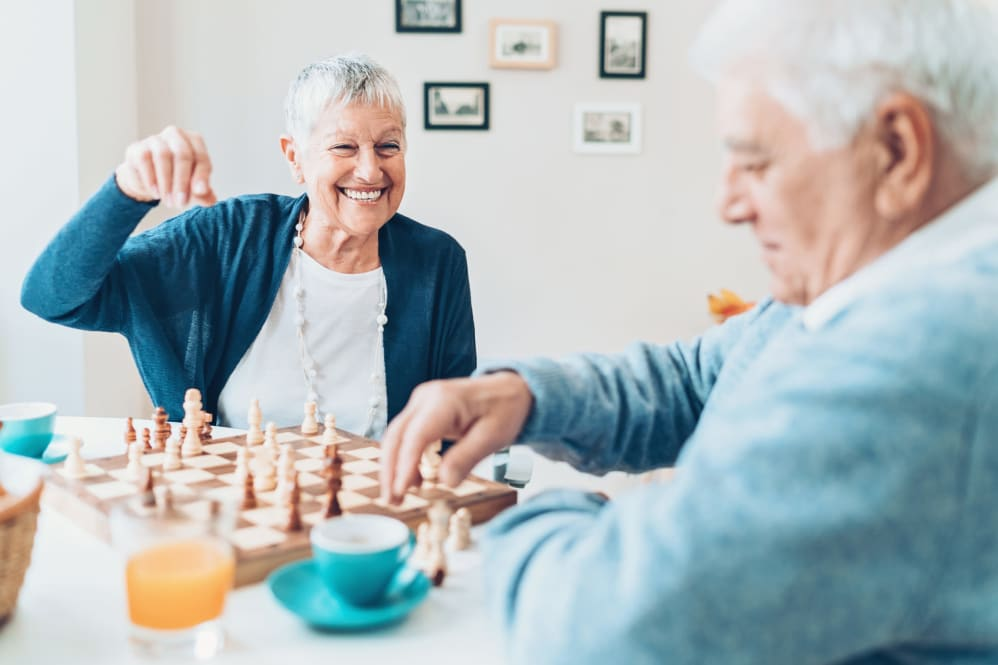 Two residents playing chess at Western Slope Memory Care in Grand Junction in Colorado