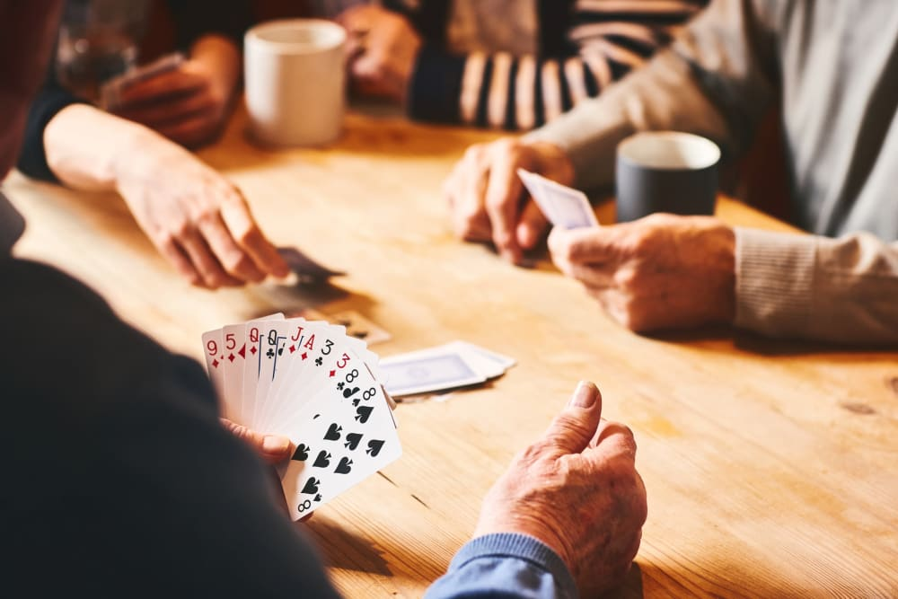 People playing cards at The Vista in Esquimalt, British Columbia.
