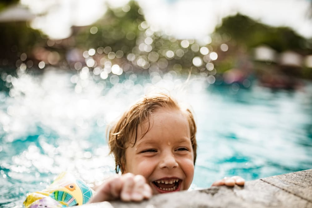 Kid swimming in the pool at Longhill Grove in Williamsburg, Virginia