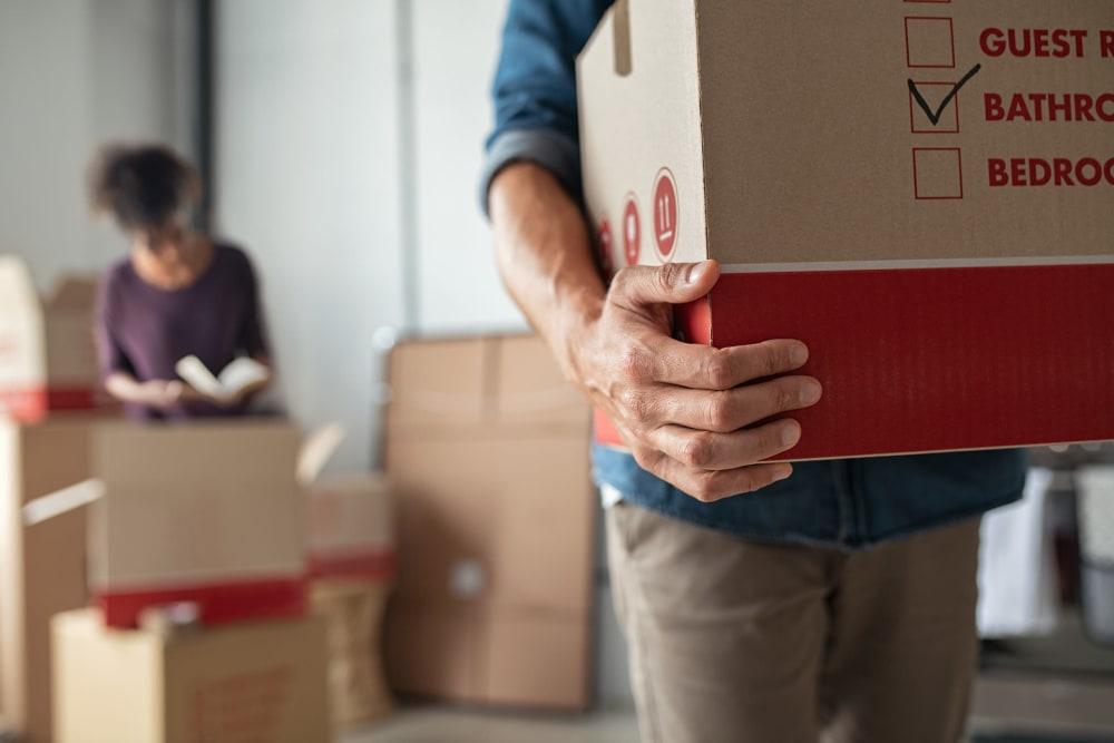 A couple moving boxes near Downtown Self Storage - Johnson Street in Portland, Oregon