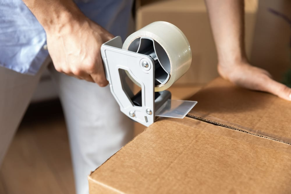 A box being closed with packing tape at A-American Self Storage in Los Angeles, California