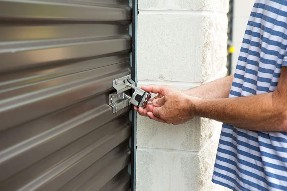 A customer unlocking his unit at Storage Star Ben White in Austin, Texas