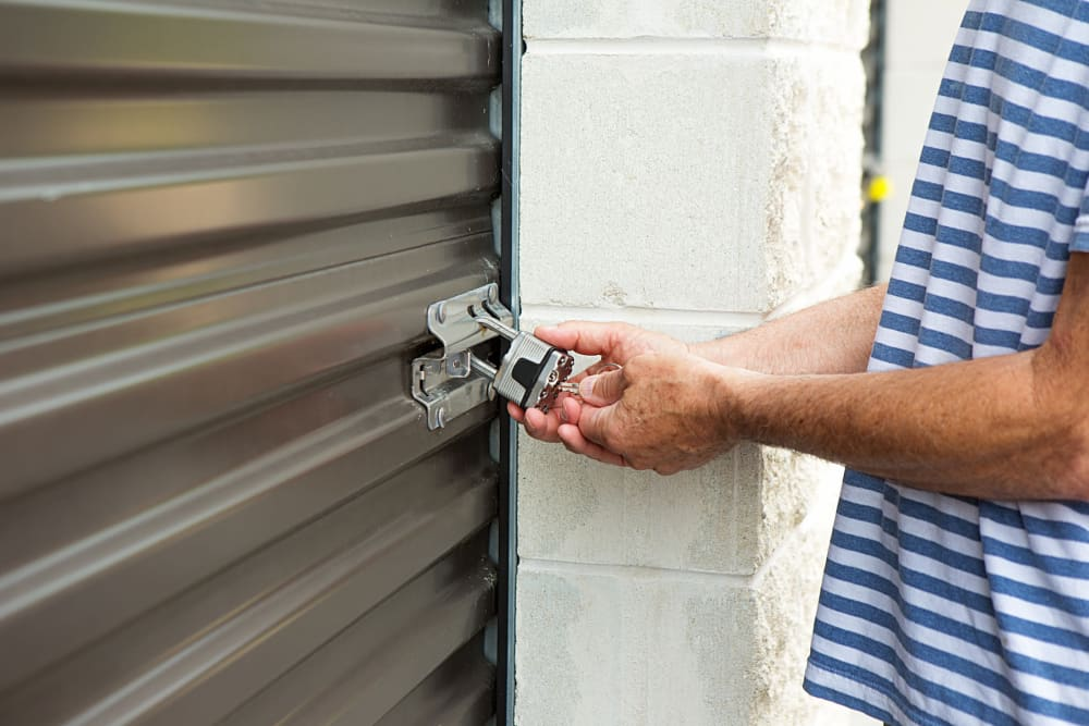 A customer unlocking his unit at Storage Star Tomball in Tomball, Texas