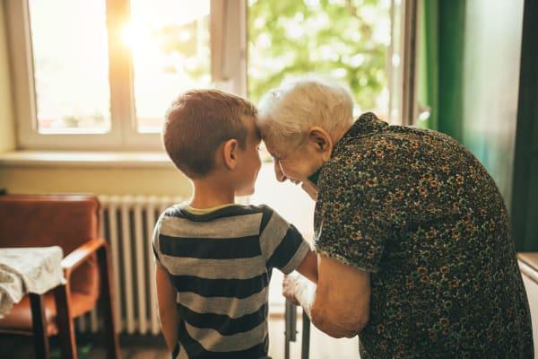 Resident with grandchild at BPM Senior Living