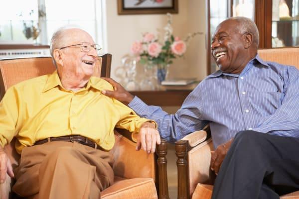 Senior men enjoying a conversation at a Claremont Retirement Management Services community