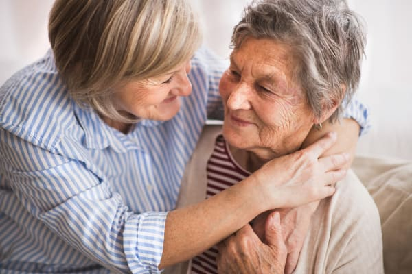 A mother and daughter hugging at Heritage Senior Living in Blue Bell, Pennsylvania
