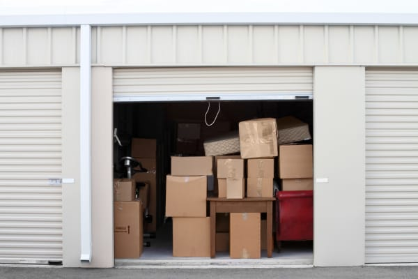 A spacious storage unit with boxes at Towne Storage in Las Vegas, Nevada