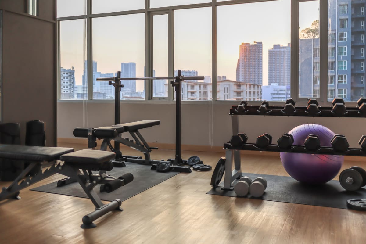 Free weights and more in the fitness center at Solera at City Centre in Palm Beach Gardens, Florida