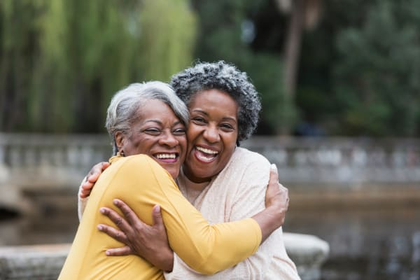 Residents share a hug at The Crossings at Eastchase in Montgomery, Alabama