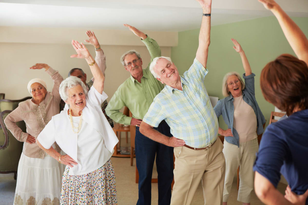Residents enjoying stretching activities at The Fountains of Hope in Sarasota, Florida.