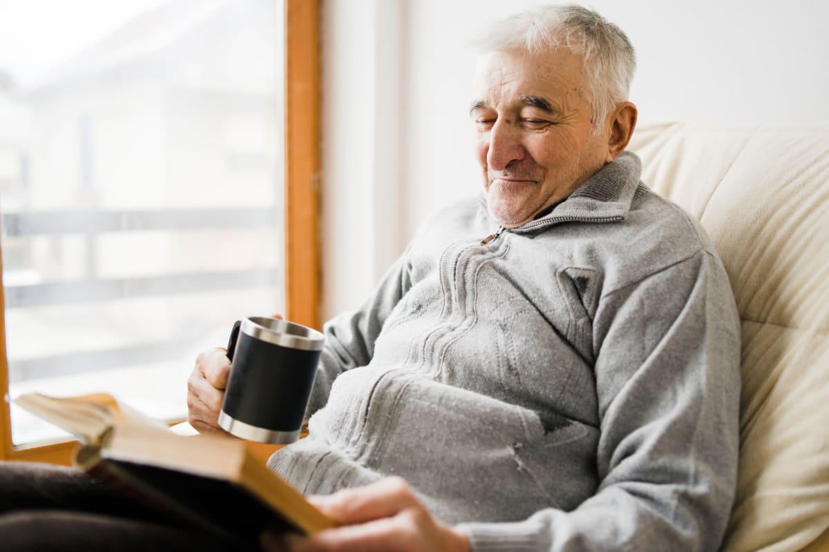 A resident using a smart phone at Oxford Glen Memory Care at Grand Prairie in Grand Prairie, Texas