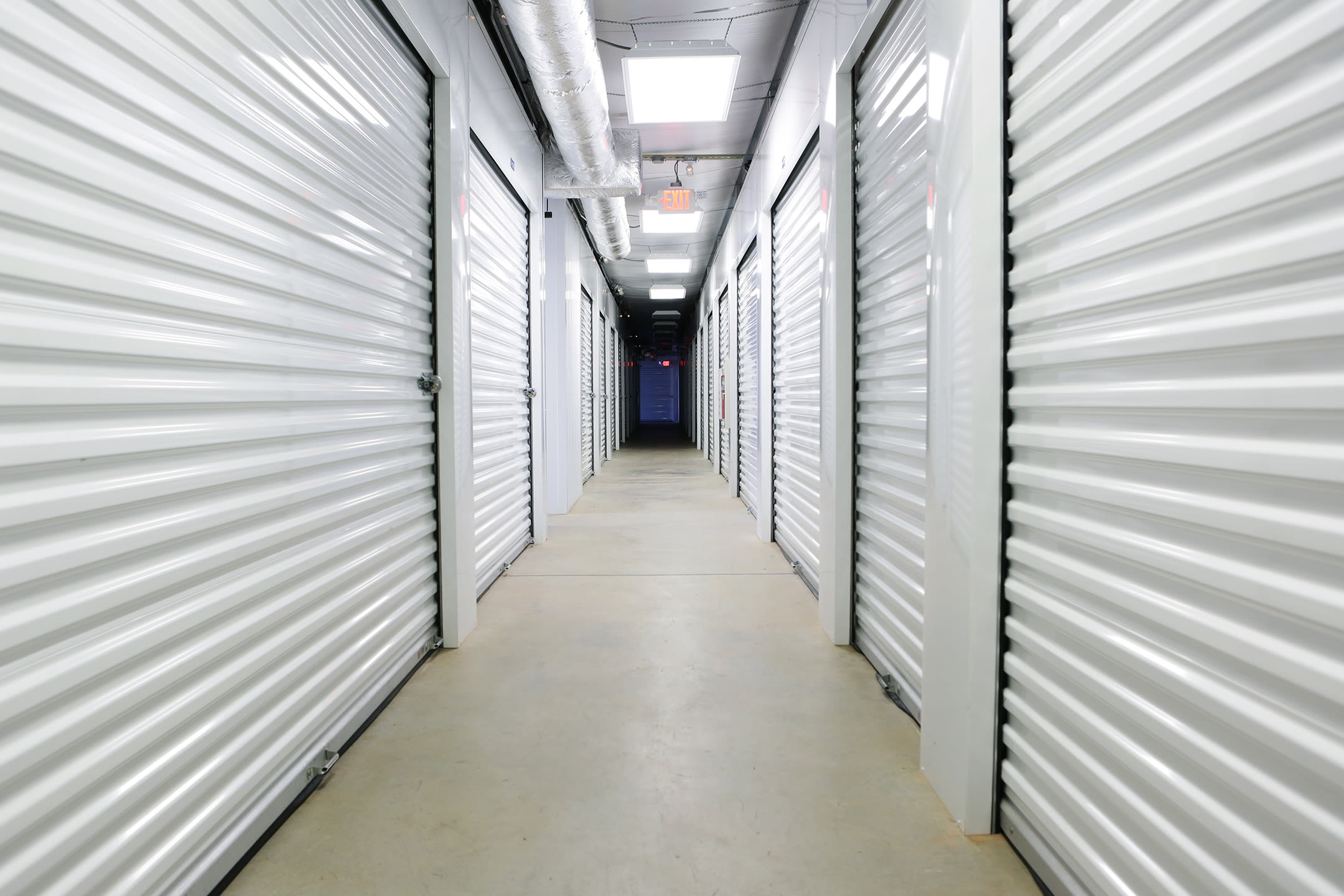 Storage units with white doors at Midgard Self Storage in Wilmington, North Carolina