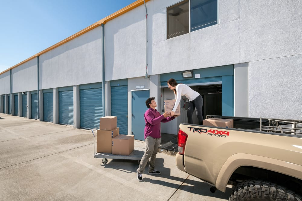 Couple unloading boxes at Castro Valley Hayward Storage LLC in Castro Valley, California